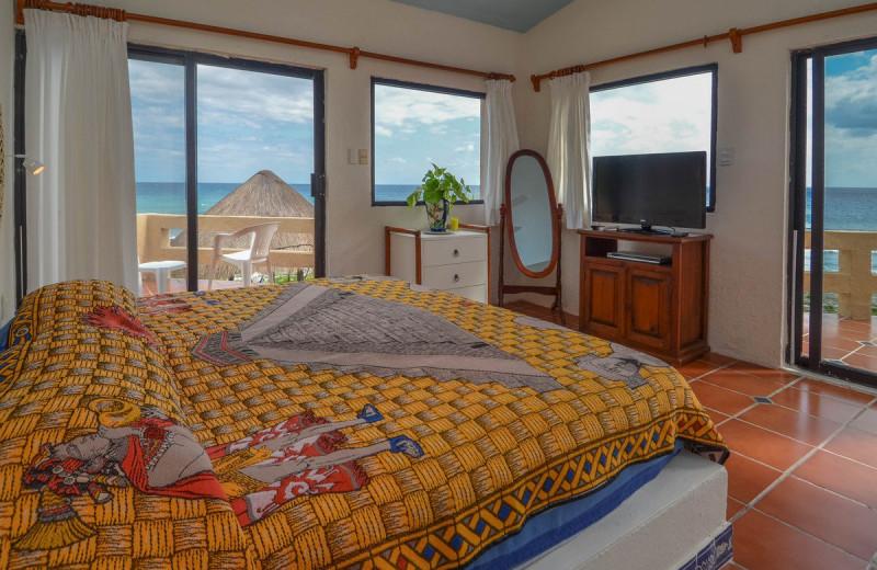 Rental bedroom at Villa Nicte-Ha.