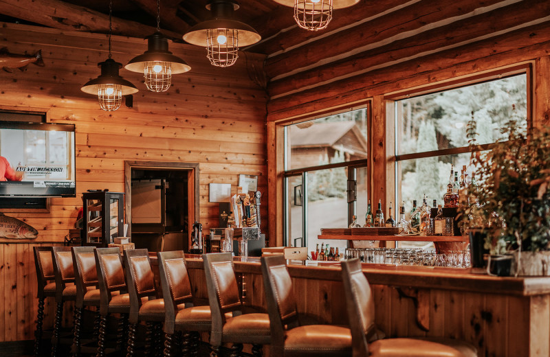 Enjoy a drink at our rustic, luxurious bar while staying at Salmon Falls Resort.