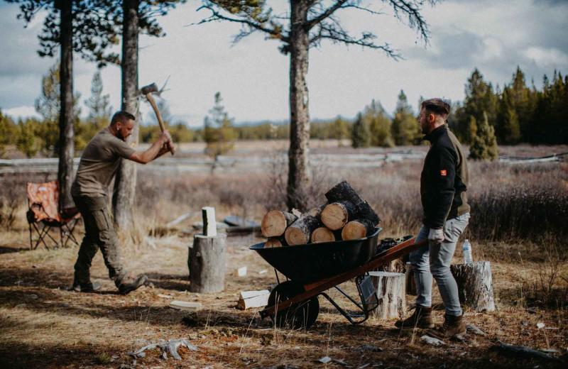 Chopping wood at Big Creek Lodge.