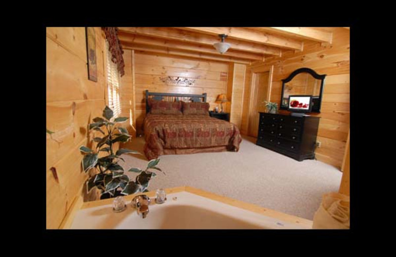 Cabin bedroom at Eden Crest Vacation Rentals, Inc - Oh Yea!