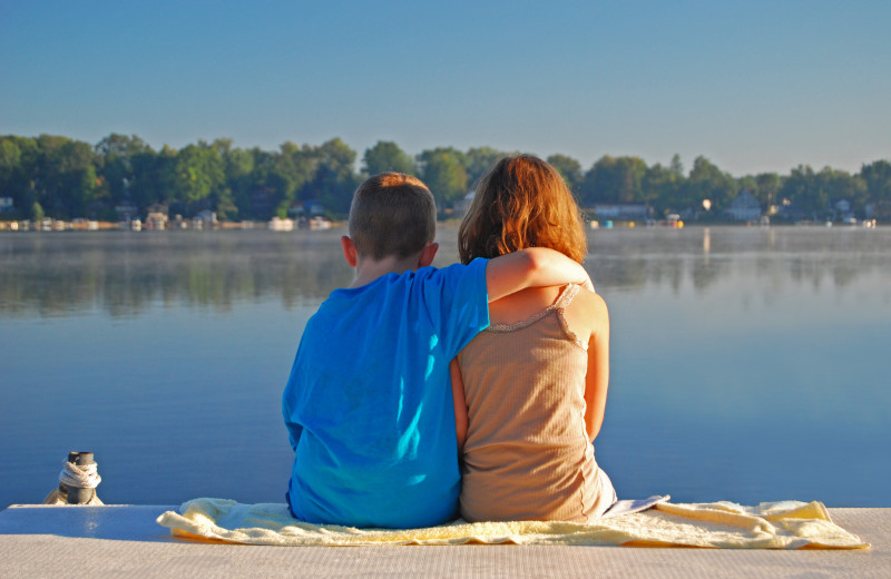 Kids by lake near Perham Oasis Travel Plaza.