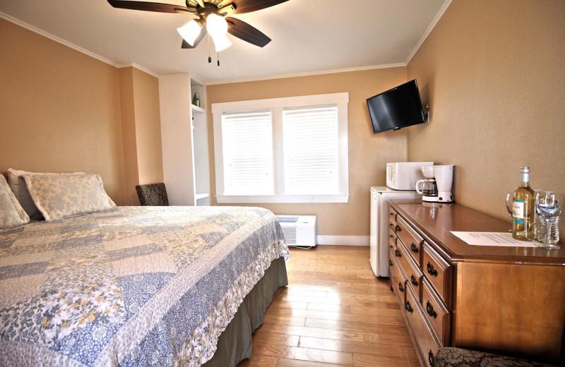 Guest room at Peach Tree Inn & Suites.