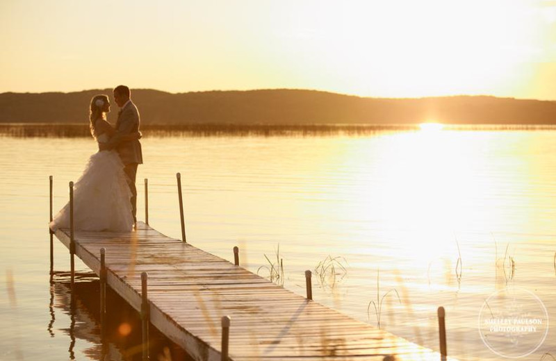 Wedding couple on dock at Madden's on Gull Lake.