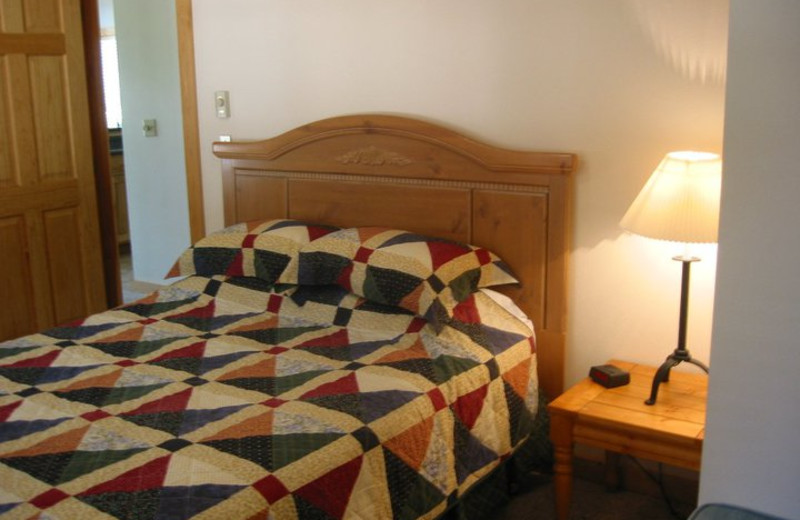 Cabin bedroom at Timberline Meadows Lodges.