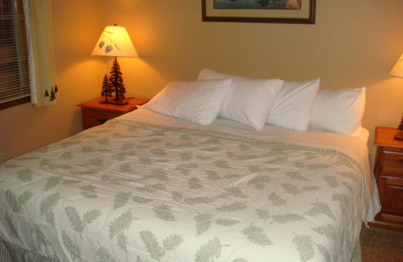 Guest bed at The Beacons of Minocqua.