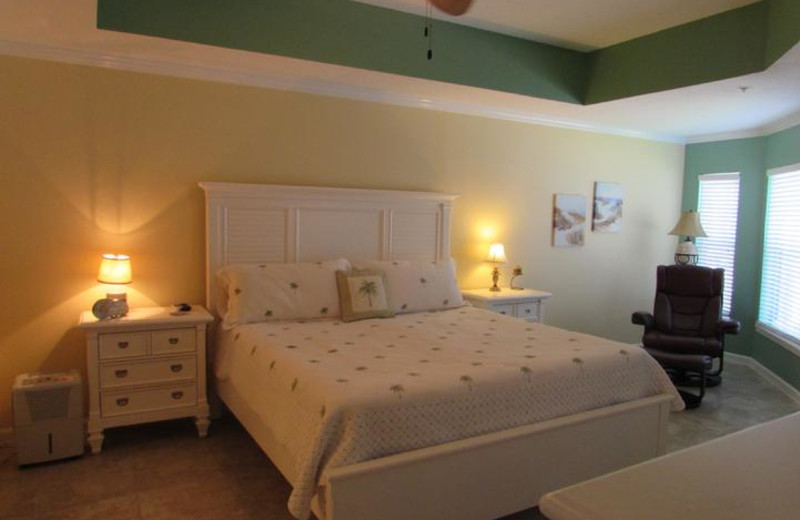 Large Master Suite with king bed, seating room, in-suite full bath and view of pool