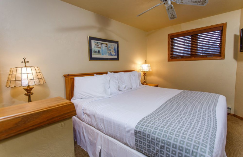 Guest bedroom at Waterbury Inn Condominium Resort.