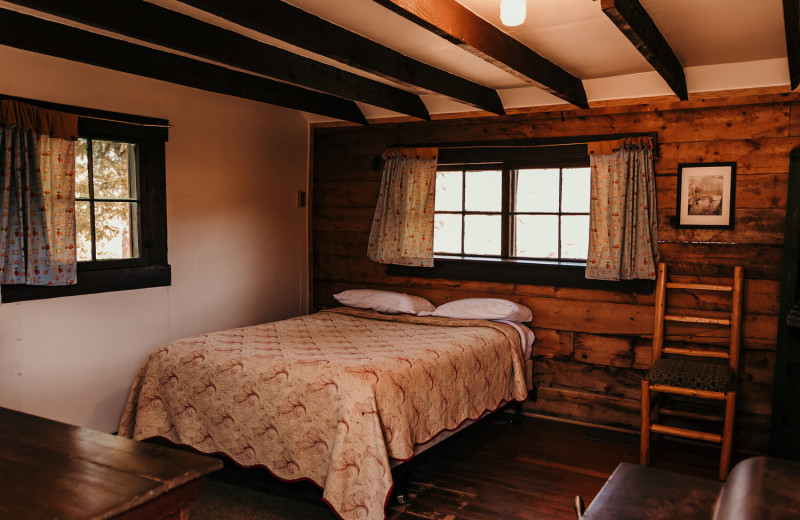 Cabin bed at Trappers Lake Lodge & Resort.
