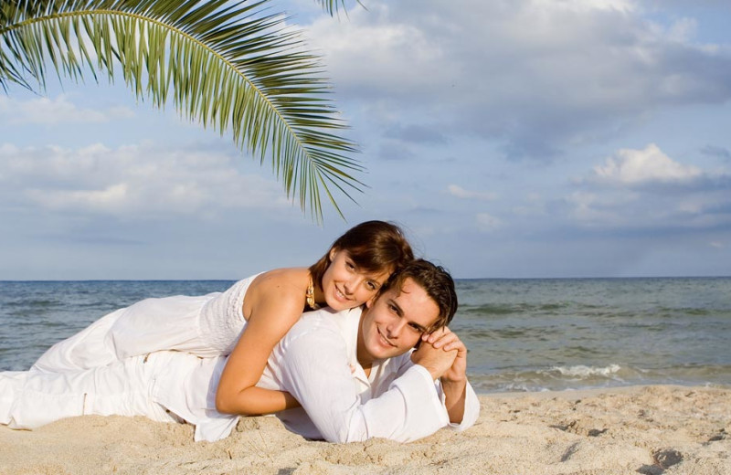 Couple on the beach at Gulf Strand Resort.