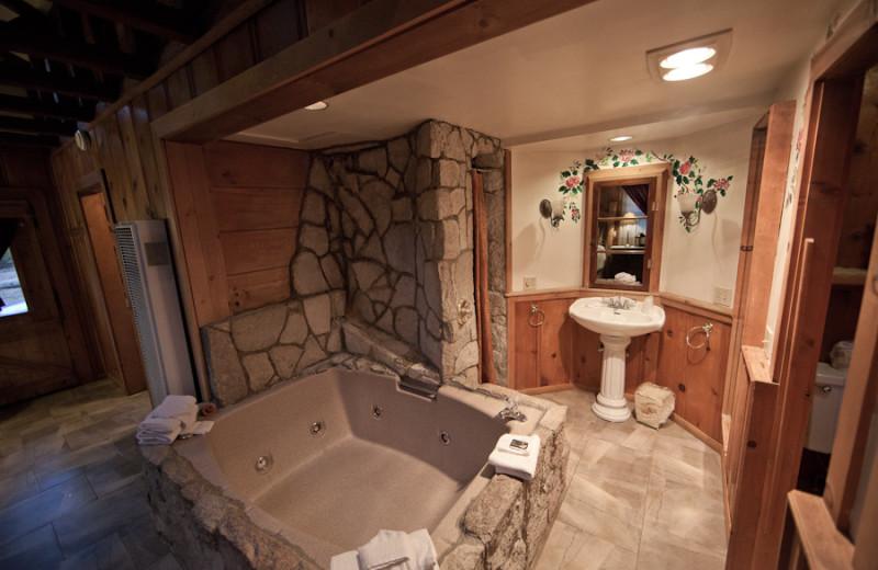 Cabin hot tub at Arrowhead Pine Rose Cabins.