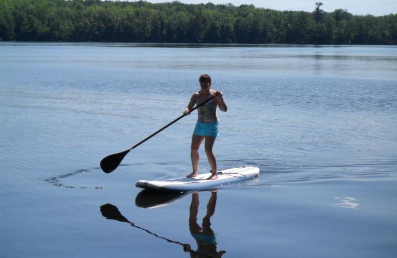 Paddle boarding at Virgin Timber Resort.