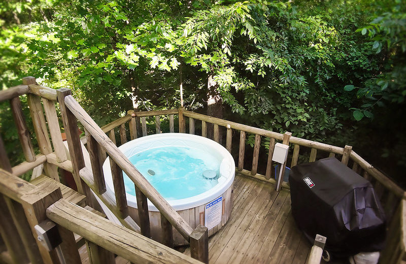 Rental deck and hot tub at Amazing Branson Rentals.