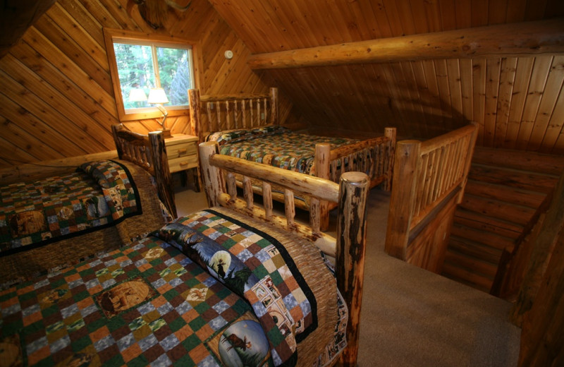Cabin bedroom at Western Pleasure Guest Ranch.