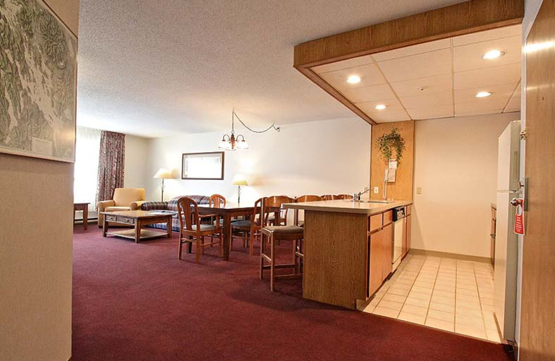 King suite dining and kitchen area at Fireside Inn & Suites at Lake Winnipesaukee.