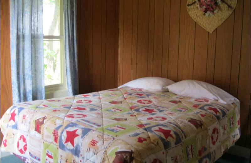 Cabin bedroom at Betsy Ross Resort.