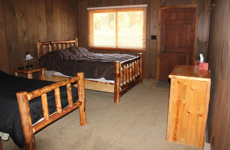 Cabin bedroom at Kendall Valley Lodge.