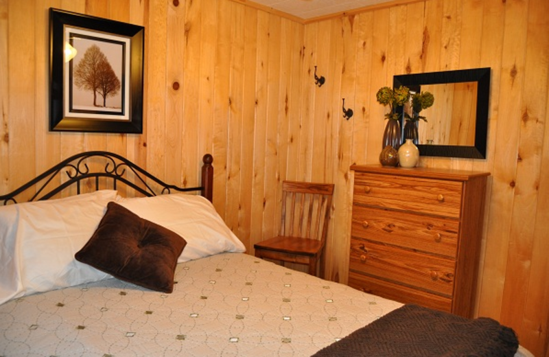 Cabin bedroom at Elm Haven Resort.