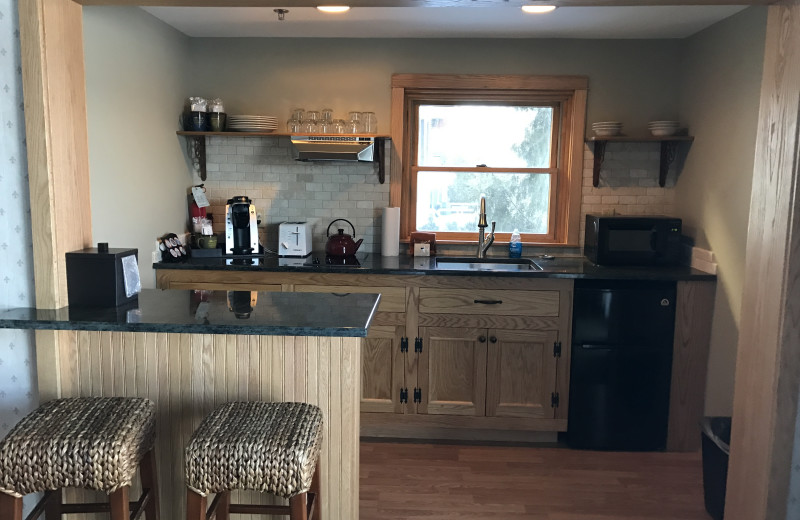 Windfall Kitchenette Featuring a Stove Top, Mini Refrigerator, Microwave, Sink, Toaster, and Breakfast Nook that Seats 4