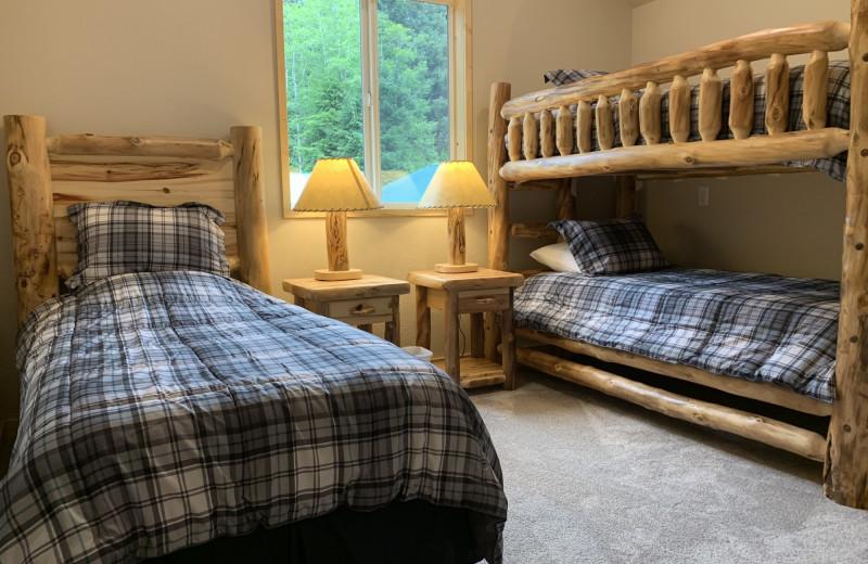 Cabin bedroom at Screamin' Reels Lodge.
