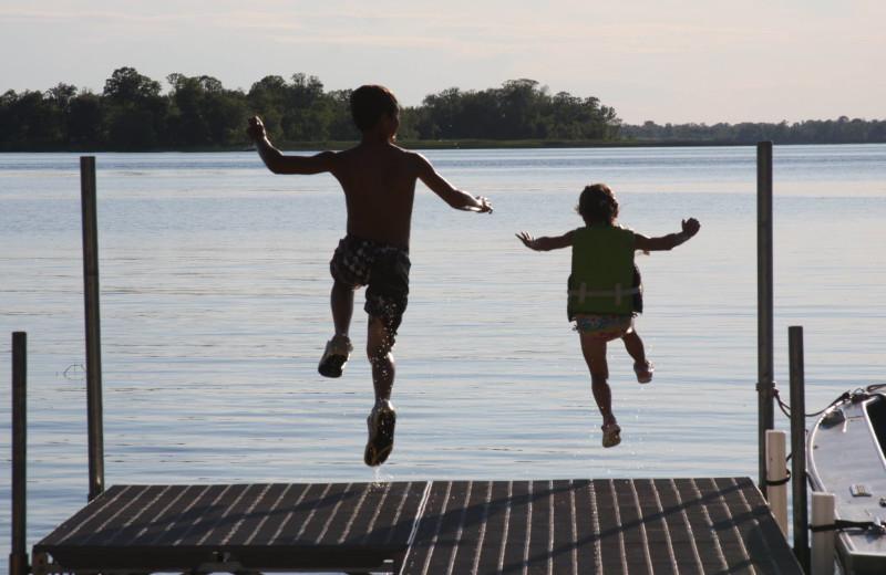 Jumping in lake at Olson's Big Pine Get-A-Way.