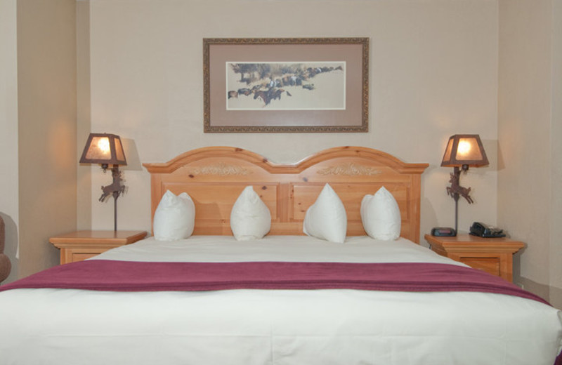 Guest bed at The Inn at Jackson Hole.