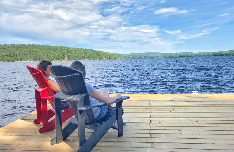 Relaxing in chairs on the dock at Killarney Lodge in Algonquin Park