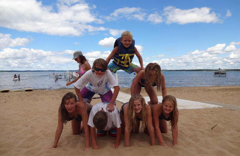 Family on beach at The Beach Haus Resort.