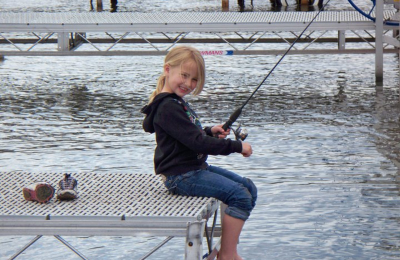 Fishing off the dock at Auger's Pine View Resort.