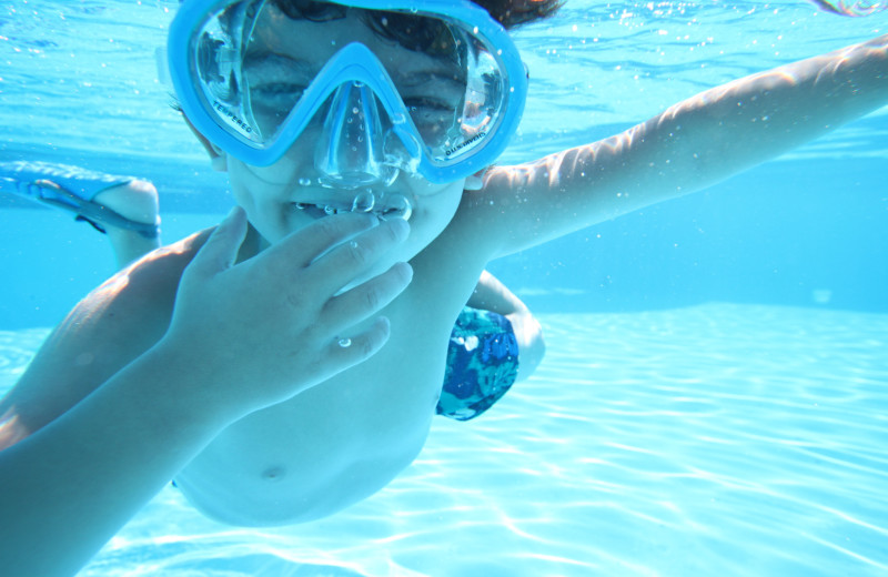 Boy swimming in pool at Kah-Nee-Ta Resort and Spa.