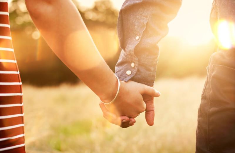 Couple holding hands at Oglebay Resort and Conference Center.
