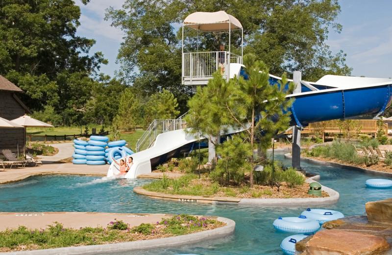 Outdoor pool and water slide at Hyatt Regency Lost Pines Resort and Spa.