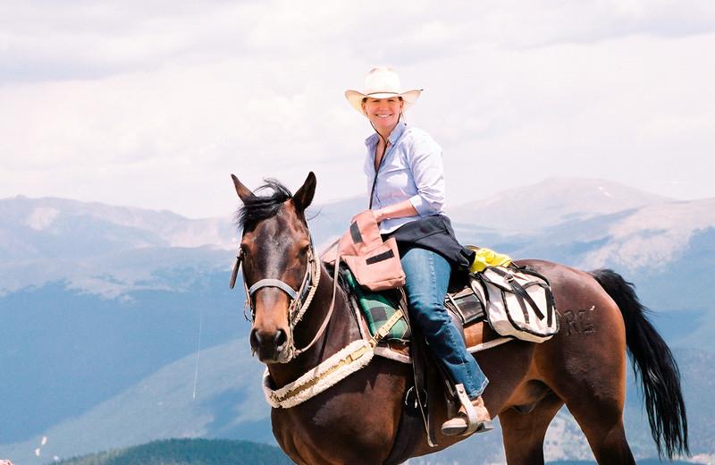 Horseback riding at Tumbling River Ranch.