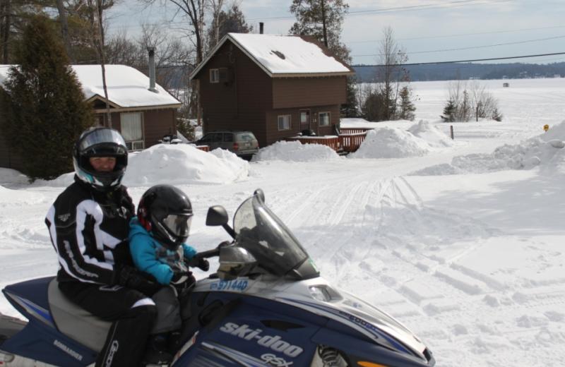 Snowmobiling at Sand Lane Resort.