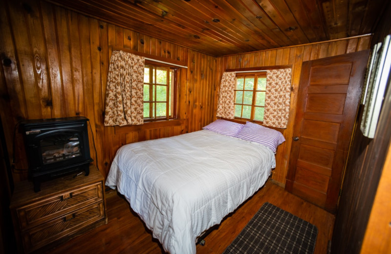 Cabin bedroom at North Shore Lodge & Resort.