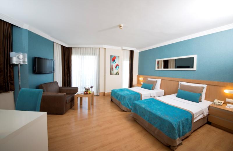 Guest room at Merit Limra Hotel & Resort.