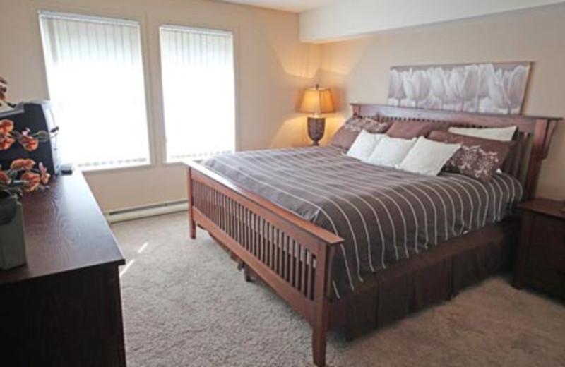 Rental bedroom at Acer Vacation Rentals Ltd.