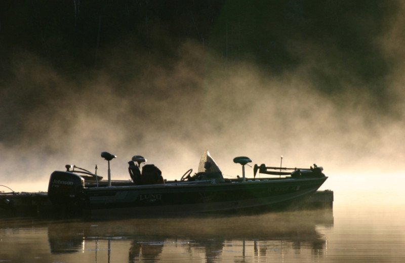 Boat in mist at KaBeeLo Lodge.
