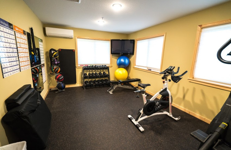Lodge Fitness Room showing bench, stationary bike and stair stepper.