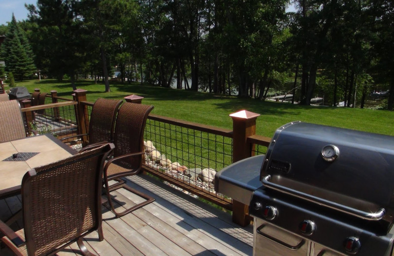 Deck with BBQ and patio table at Boyd Lodge.