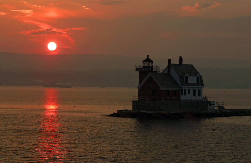 Light house sunset at Mount Battie Motel.