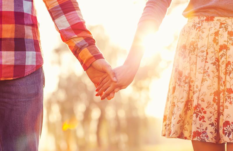 Couple holding hands at Baumann's Brookside Summer Resort.