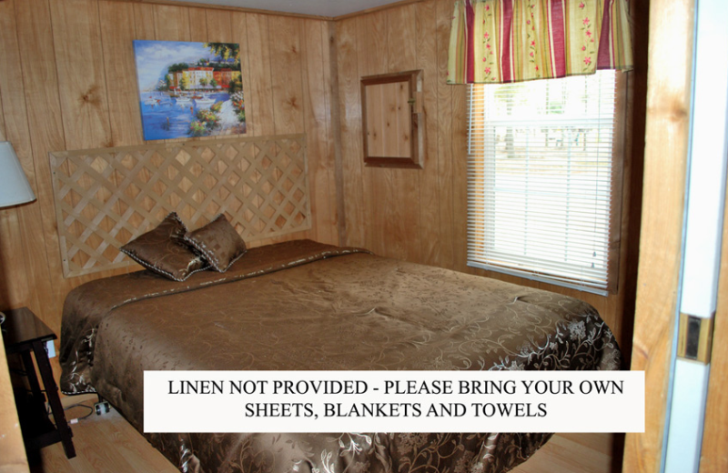 Cabin bedroom at Gulf Pines RV Park.
