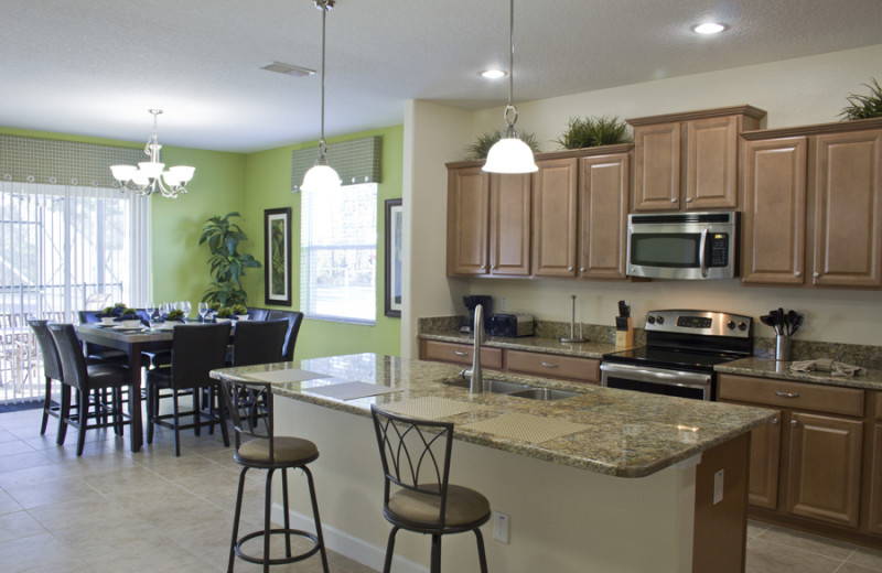 Rental kitchen and dining area at Florida Dream Management Company.