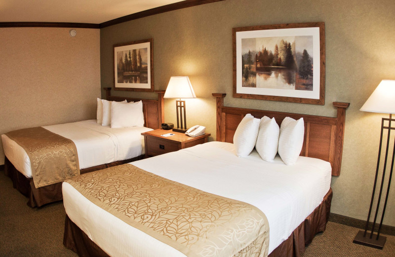 Double queen beds, and bathroom with shower. Double Queen rooms are available with tub. Rooms feature flat-screen television and wireless internet access.
