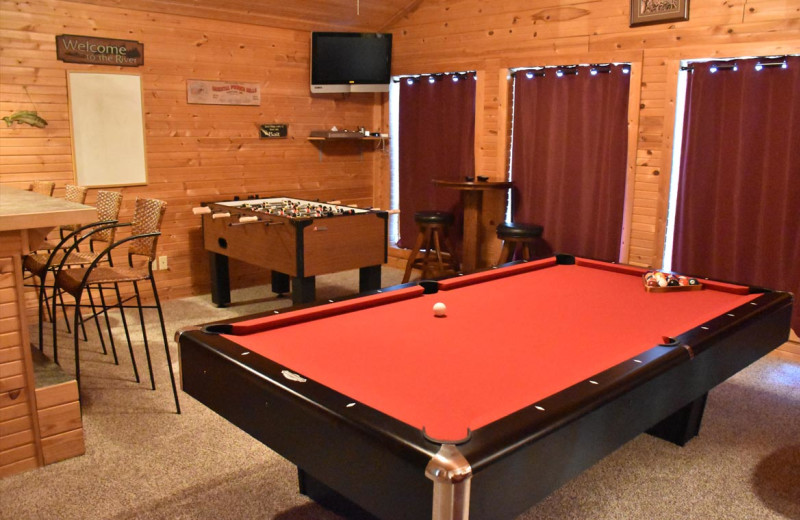 Cabin game room at Can-U-Canoe Riverview Cabins.