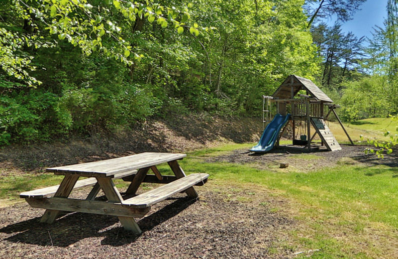 Picnic table and playground at  Little Valley Mountain Resort