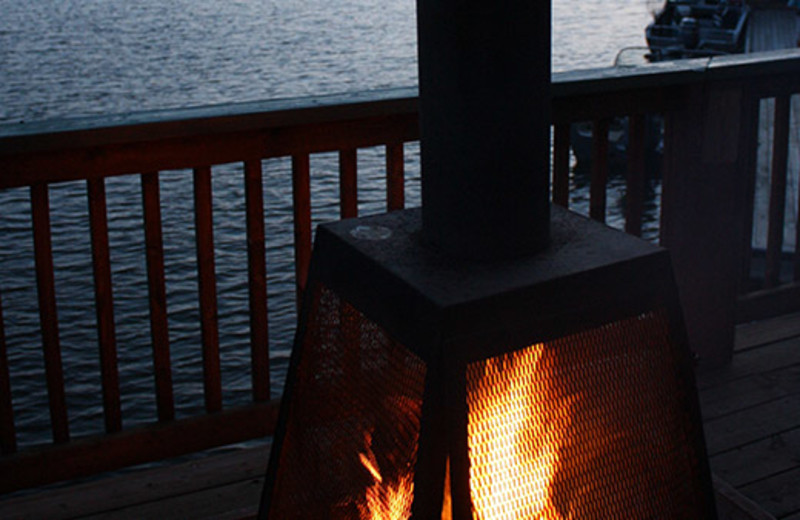 Deck fireplace at Shady Roost Lodge.