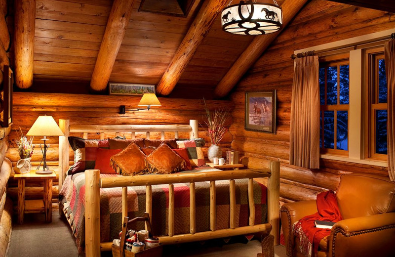 Cabin bedroom at Averill's Flathead Lake Lodge.