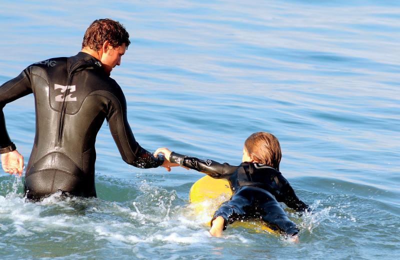 Family surfing at The Ritz-Carlton, Laguna Niguel.