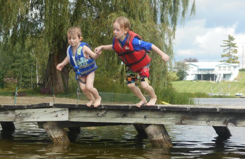 Jumping in lake at Lake George Resort.